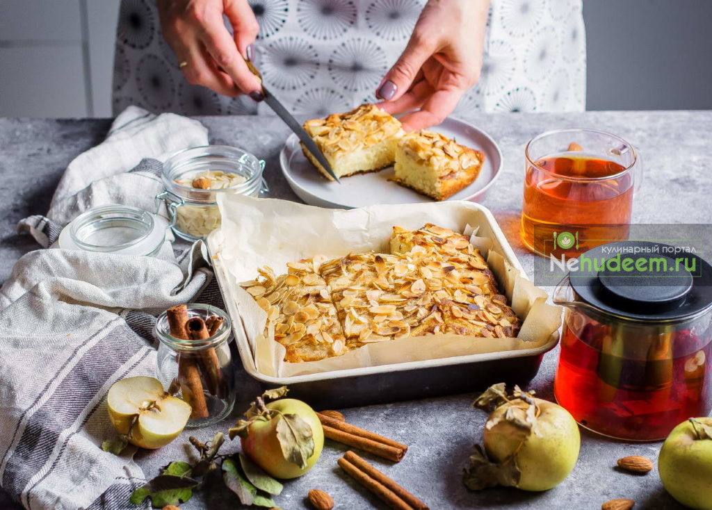 Woman cuts piece of homemade apple pies. Norwegian Biscuit Pie on stone concrete table background. Scandinavia Kitchen